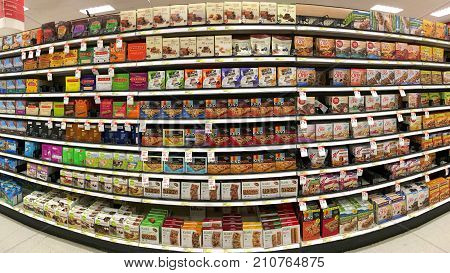 San Leandro CA - October 12 2017: Grocery store shelf with boxes of breakfast and health food bars various brand names.