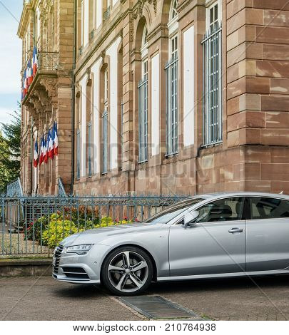 STRASBOURG FRANCE - OCT 1 2017: Side view of Luxury Audi A8 S-Line car parked in front of the City Hall of Strasbourg