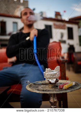 Man Smoking Shisha Outdoor, Unhealthy Concept
