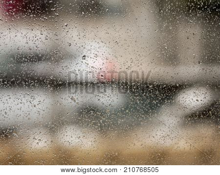 water drop on glass mirror after rain background concept