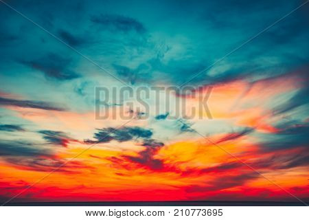 Sunset sky background. Natural Sunset Sunrise Over Ocean. Bright Dramatic Sky And Blue Water. Colorful Nature Landscape