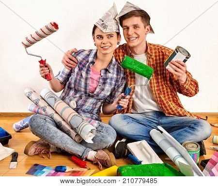 Repair family by happy couple building home. Quarrel family because of renovation in new apartment. Profitable loan for repairs. Sister and brother in new apartment.