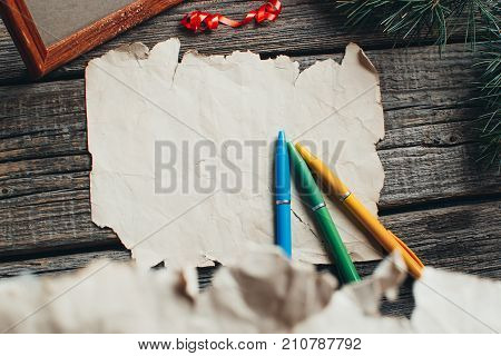 On The Wooden Table Are An Old Yellow Paper That Said: Dear Santa Claus