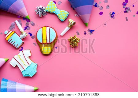 Cook gingerbread cookies with ticker tape for baby shower on pink desk background top view mockup poster