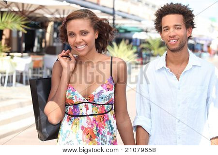 black young couple walking in the street