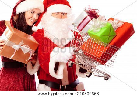 mr and mrs santa claus with a shopping cart