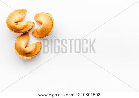 Chinese fortune cookie with prediction on white desk background top view space for text