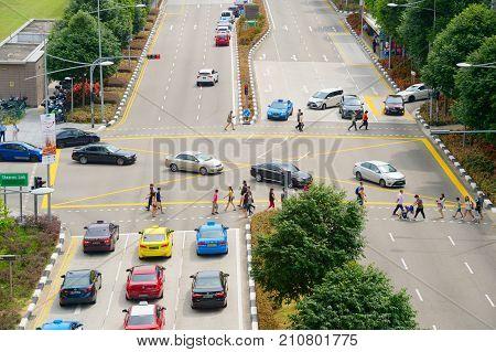 People Crossing Multilane Road. Singapore