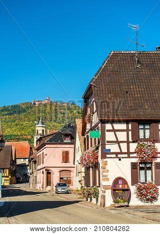 Saint-Hippolyte village with Haut-Koenigsbourg castle on top of a mountain - Haut-Rhin, France