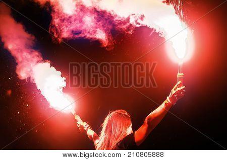 Concert Crowd Holds Smoke Bombs
