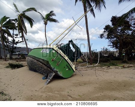 Airlie Beach, Queensland, Australia-March 30, 2017:  Boat aground resulting from Cyclone Debbie, category 4.9 cyclone that hit Airlie Beach on Tuesday, 28th March 2017.