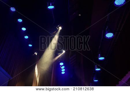 Color lighting lamp in the concert stage. Color lamp floodlights on the ceiling. Soffit lamp illuminate the scene. Electric lamp. Lamp on stage for a concert