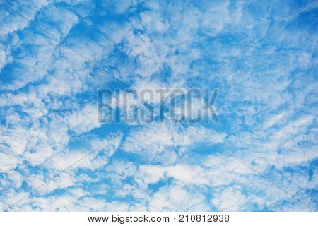 White clouds against the blue summer sky. Blue sky with white clouds. Clear sky. Clouds in the sky. Beautiful sky. Summer day sky. The clouds flies in the sky. Blue cloud in the sky.