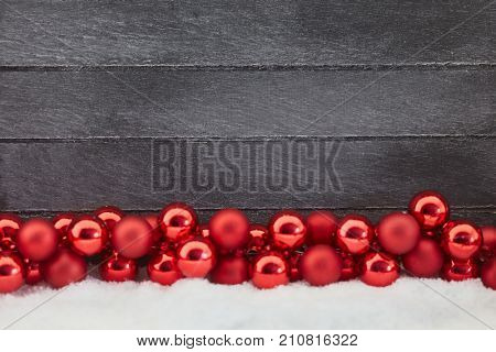 Red christmas balls decoration as christmassy background