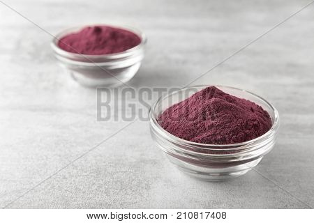 Bowls with acai powder on table