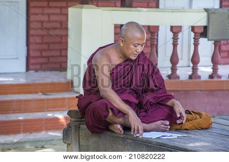 AMARAPURA MYANMAR - SEP 03 : Monk at the Mahagandayon Monastery in Amarapura Myanmaron September 03 2017 Mahagandayon Monastery has 2000 monks at any given time.