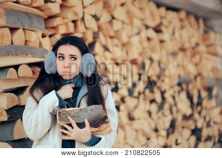 Girl Feeling Cold Holding Firewood in Winter Time