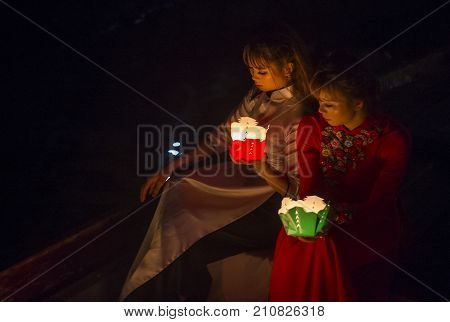 HOI AN VIETNAM - OCT 04 : Vietnamese women holding lanterns before droping them into the river in Hoi An Vietnam during the Hoi An Full Moon Lantern Festival on October 04 2017