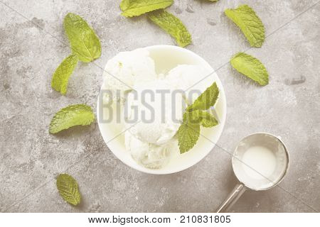 Mint Ice Cream In Bowl On A Gray Background. Top View. Food Background. Toning
