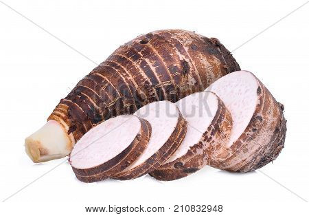 whole taro root with slice isolated on white background