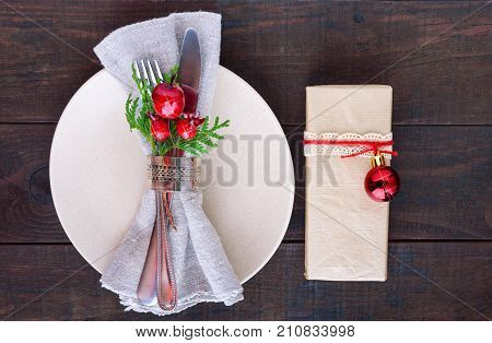 Christmas table decoration. Christmas dinner plate cutlery decorated festive decorations. Winter holidays. Christmas card. Free space for your text. Merry Christmas Happy New Year.