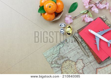 Table top view of the Chinese & Lunar new year and accessory travel concept background.Essential items for the season.Variety object on the modern wood.Other language mean rich or wealthy and happy.