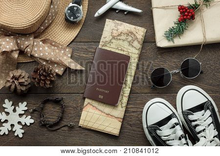 Table top view of ornaments and decorations Merry Christmas and Happy New Year with accessory travel concept background.Essential item on modern rustic home office desk.object prepare for travelling.