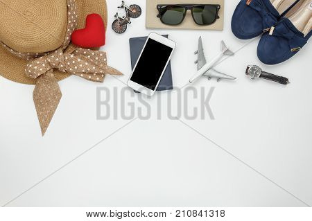 Table top view of accessories fashion women to travel concept.Mix essential objects on the modern wood white background at home office desk.Items for traveler teen or adult to holidays and copy space.