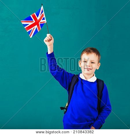Little Schoolboy With National Flag Of The United Kingdom