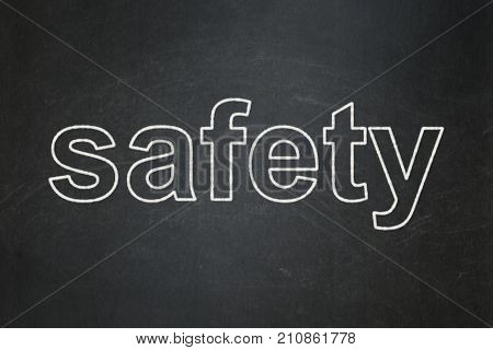 Safety concept: text Safety on Black chalkboard background