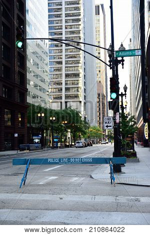 Chicago Illinois - July 16 2017: Street closed by a blue wooden police barricade for a sports race in Chicago Illinois. Everything ready for the celebration of rock and roll half marathon Chicago