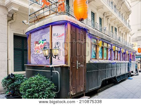 Shanghai, China - Nov 6, 2016: On Nanjing Road Pedestrian Street - Modern buildings in western architectural designs. A railway carriage converted to a restaurant.