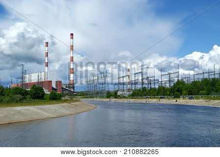 RUSSIA PERM - JUNE 12 2015: spillway and building of machine room on thermal power station in Dobryanka Perm Krai