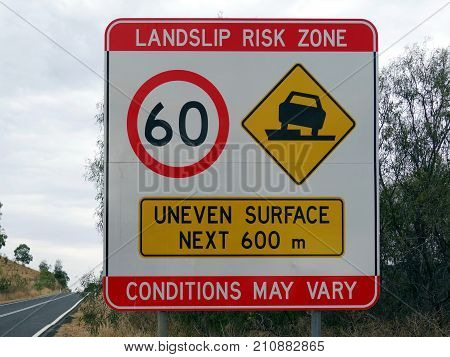 A speed sign warding of  a landslip risk zoned and uneven surface for the next 600m