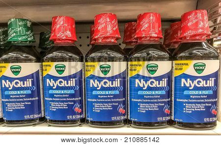 New York October 23 2017: NyQuil bottles stand on a store shelf.