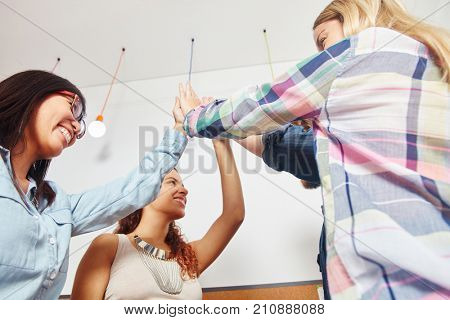 Successful business High Five in a team as consent