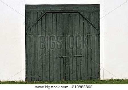 Black Wooden Barn Door On A White Wall