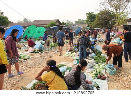 Vang Vieng Laos - May 5 2017 : Laotian people walking in Village morning market outside Vang Vieng Laos