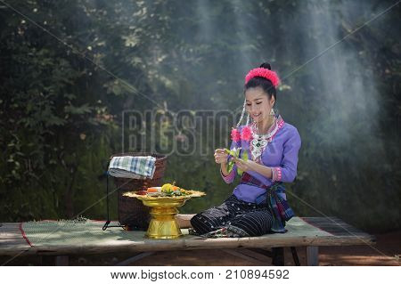 Beautiful Laos girl in costumeAsian woman wearing traditional Laos culturevintage styletraditional suit.