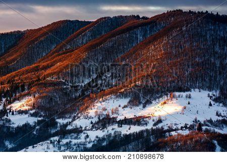 Hillside In Red Light On Winter Sunrise
