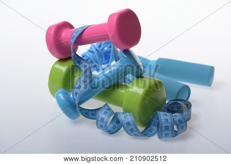 Dumbbells And Skipping Rope In Cyan, Pink And Green Color