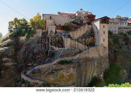 Meteora Greece - 9 October 2017: Visitors climbing the steps of Varlaam Monastery at Meteora rocks in Greece