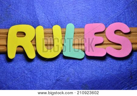 the word rules on a  abstract blue background