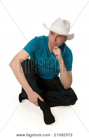 Man In A Cowboy Hat Sitting In The Lotus Position
