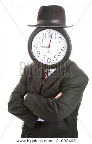 Stock photo of anonymous businessman with a clock for a face, standing with his arms folded.  Isolated on white.