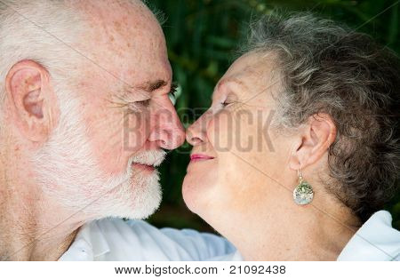 Closeup view of a senior couple in love, flirting with each other.