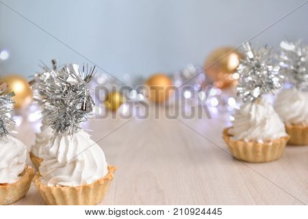Christmas cakes with silvery decor, ideas for the new year, background, soft focus, bokeh