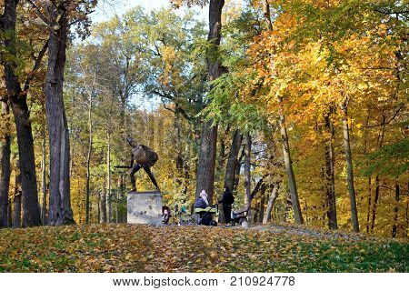 BILA TSERKVA UKRAINE - OCTOBER 18: The visitors are in Olexandria Park on October 18 2017 in Bila Tserkva Ukraine. More then 12 mln tourists is expected to visit Ukraine in year 2017.