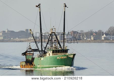 New Bedford Massachusetts USA - April 12 2017: Fishing vessel Acores in New Bedford's outer harbor on hazy morning