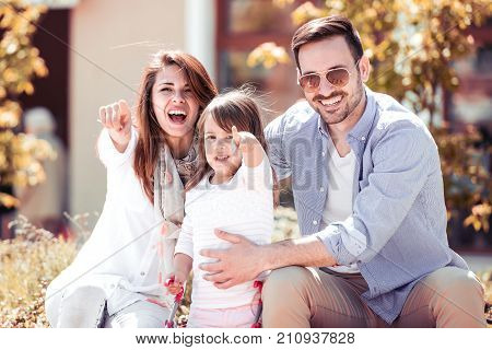Happiness and harmony in family life. Happy family concept. Happy family resting together in the city. Family having fun outdoor